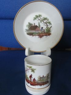 Amstel porcelain - cup and saucer polychrome painted with water landscapes