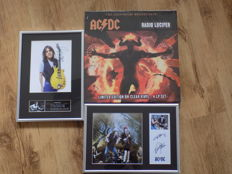 "AC/DC "" Radio Lucifer "" 4LP box set , Malcolm Young & Brian Johnson & Angus Young framed photographs with printed signatures."