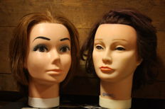 A pair of 2 Vintage woman heads.  rubber / celluloid ( practice heads )