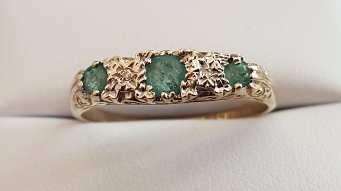 Old cut natural colombian emeralds with diamonds in a half eternity band