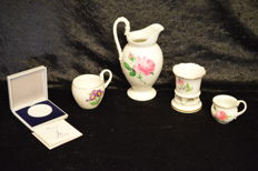 Meissen - footed vase and 2 mocha cups, a milk jug and a Meissen thaler