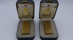 Two Dunhill Rollagas lighters - with box and papers