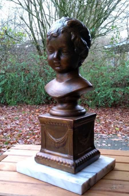 Beautiful bronze bust of young girl on marble base