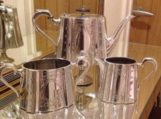 Antique English silver plated three piece tea set with rich decorations