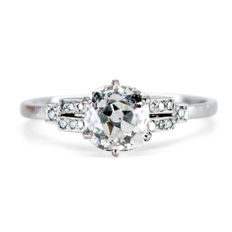 Art Deco ring featuring 1,14ct (H S1) Cushion Cut Diamond decorated with 0.07ct Diamond accents in Platinum.
