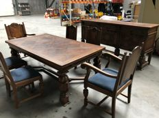 An oak wood table, buffet and 6 chairs in Renaissance style, Belgium, circa 1930