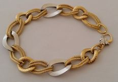 Women's bracelet in 18 kt white and yellow gold Weight: 6.45 g