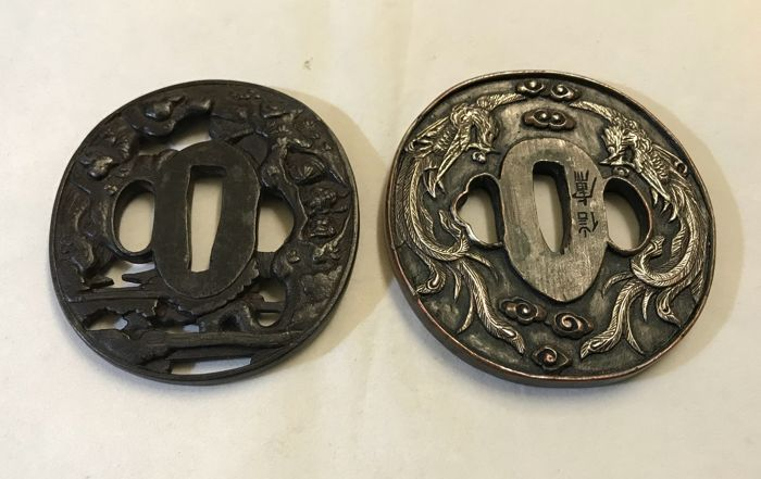 Iron tsuba's one with decorated with Samurai, one with dragons - Japan - lte 20th century
