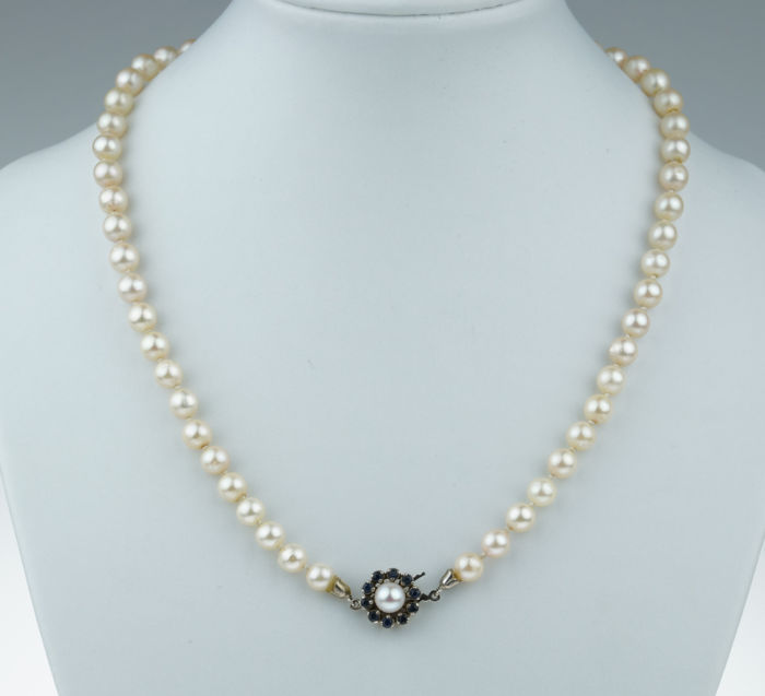 Cultured freshwater pearl necklace on a 14 kt white gold clasp set with sapphires