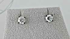 1.04 c E/VS1  round diamond stud earrings 14 kt white gold