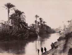Gabriel Lekegian (active circa 1887-1925) Oasis and Bedouins by the Nile, Egypt