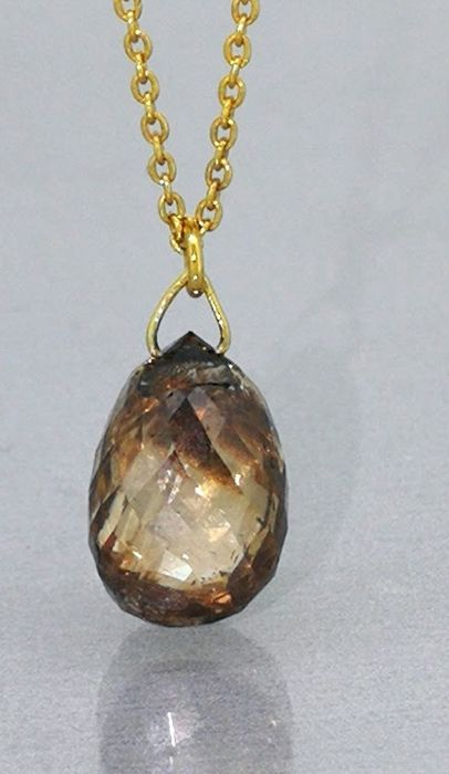Pendant decorated by a  unique briolet cut diamond 2.00 ct, in  cognac colour