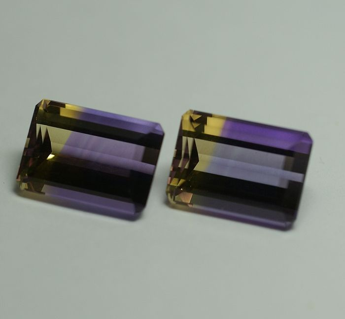 2 Ametrines,   bi-coloured (violet-yellow)  -15.20 ct