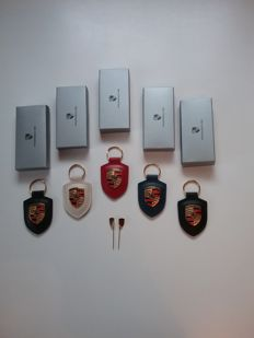 Porsche - Five metal and leather keyring and two pins for jacket