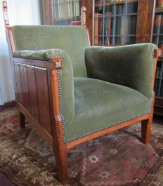 A.J. Kropholler - New Art armchair with carving of stylised parrots