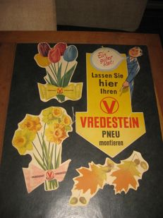 "4 ""vredestein"" advertising signs."
