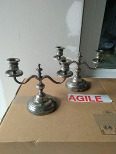 Pair of silver plated metal candle-holders
