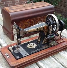 Manual sewing machine with a dust cover, Leeuwarden, Friesland, Netherlands, ca. 1920
