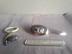 Elegant heavily silver plated baby dressing table set with rattle.