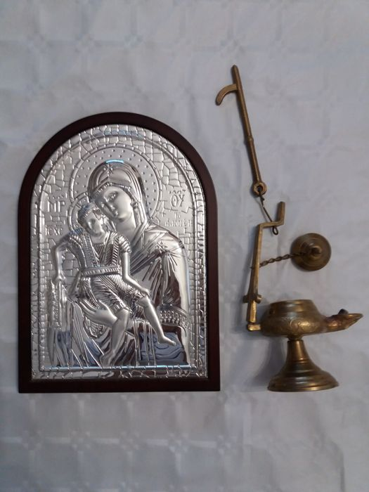Silver plated Christian Church icon and old bronze lamp