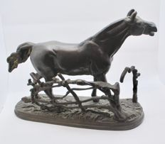 Bronze statue of a horse, standing in a field, behind a fence - 20th century