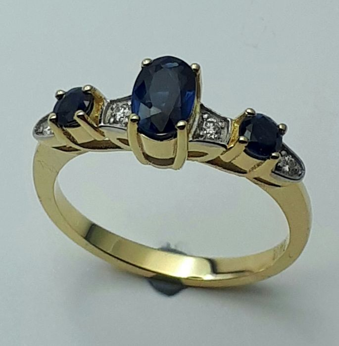 Sapphire & Diamond Ring, 14 CT yellow and White Gold, size 16.50mm, Total Weight 2.61g.  No reserve price