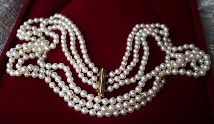 Vintage quality three-strand necklace with 0.44ct Diamonds (H/VS) and 307 genuine Japanese sea/salty AA+ Akoya pearls set with 18Kt. gold clasp. Top condition. **NO RESERVE**