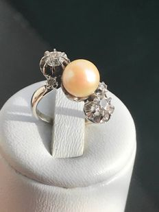 Antique ring in white gold and platinum 'You & I' model with pearl and diamonds of 0.52 ct