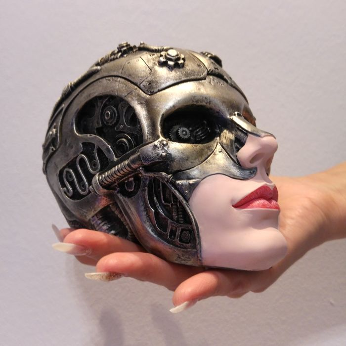 Extravagant sculpture of female head, striking details, hidden compartment