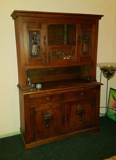 German solid oak buffet with beautifully carved panels - ca. 1910.