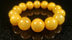 Egg yolk colour round modified beads Baltic amber bracelet, big size...hole ca. 66 mm, 43 grams