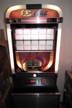 Jukebox NSM FIRE for 100 CDs with bottom cabinet with built-in speakers, wall bracket and diagram complete 1970s