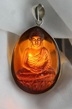 Blue Amber large pendant of sittiing Buddha in solid silver, one piece carving, 13.3 grams