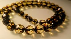 100% Genuine Faceted rare green tint Baltic amber necklace, length 47 cm, 16 grams