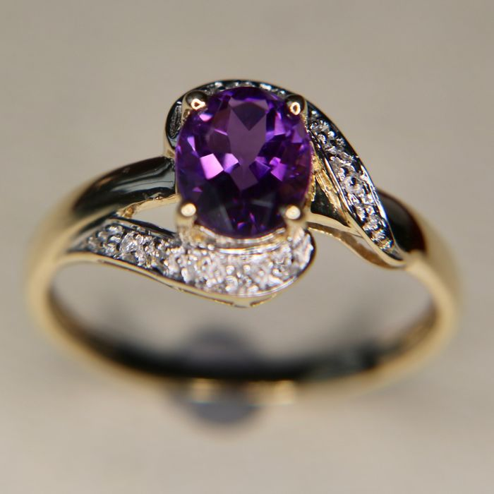 Vintage goldsmith work. 14kt. Gold ring with natural high quality Amethyst ca. 8.5 × 7mm, small diamonds set in white gold, very good condition.