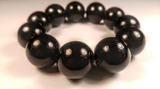 Black round modified beads Baltic amber bracelet, hole ca. 56 mm, 52 grams