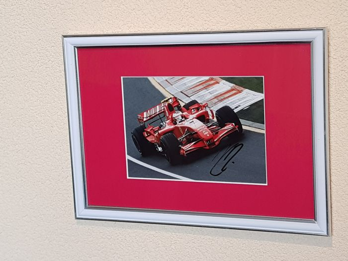 Kimi Raikkonen - Worldchampion Formula 1 - hand signed framed photo + COA.
