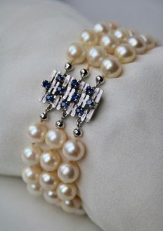 3-row Pearl bracelet with genuine Japanese See /Salty pearls ca. 7-8 mm and white gold lock with 10 blue Sapphires.