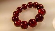 Cherry colour Round modified beads Baltic amber bracelet, hole ca. 55 mm, 38 grams