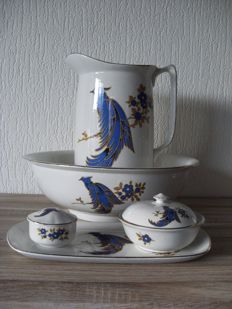 Old four-piece ceramic wash set with blue-gold design