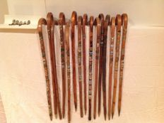 15 walking sticks with plaques and 13 loose plaques