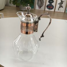 Antique glass wine decanter, with a silver plated mount