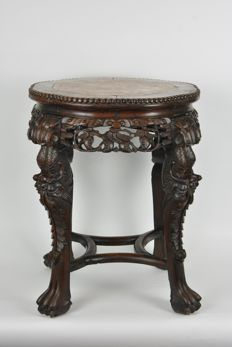 Table made of sculpted tropical hardwood - China - late 19th / early 20th century