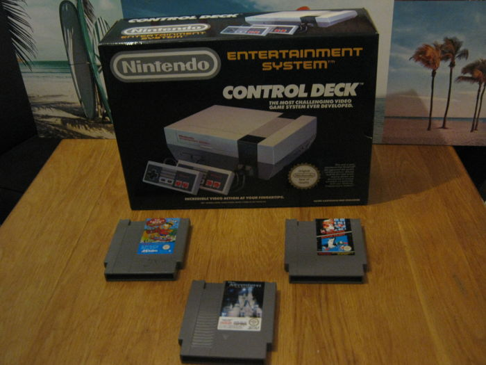 Nintendo NES boxed including 3 games like: Mario + Simpsons + Disney adventure.