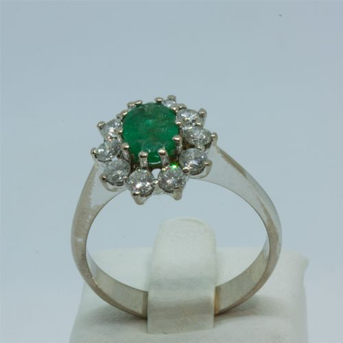 Cocktail ring with emerald and diamonds, size 18