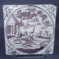 Tile, with manganese decor depicting the life of a farm at the border of the sea,