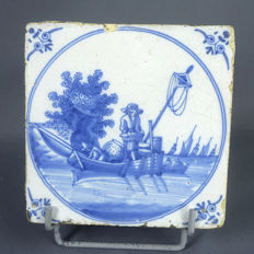 Tile, decor in light blue, representing two fishermen in their boat