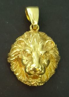 18 kt gold pendant, lion's head, weight: 10.75 g - 32 x 20 mm