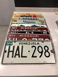 Number plates. 8 x USA, 1 x Venezuela, 2 Italian, 1 French, 1 German and 3 Spanish