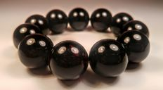 Huge Black colour Round modified beads Baltic amber bracelet, hole ca. 57 mm, 66 grams
